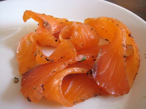 Gravlax, a kind of cured salmon, is a classic Swedish food. Growing up, I ate it with pumpernickel bread, fennel, dill, and mustard. It's great as an appetizer or part of a smörgåsbord. It's also fun to pair gravlax with non-traditional flavors, such as rye blini or  chili and corn pancakes.