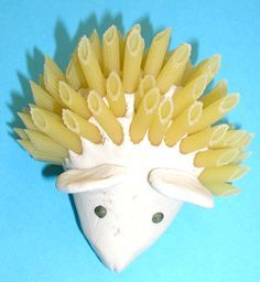 A hedgehog using salt dough modeling and natural accessories such as pasta, beans ...