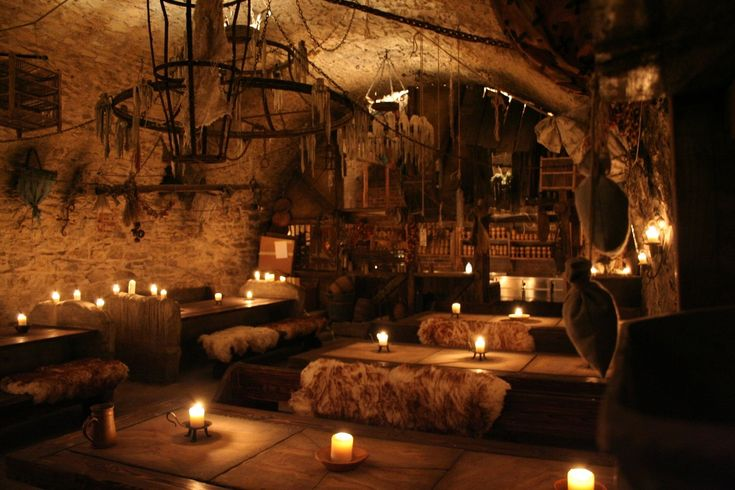 Medieval tavern in Prague - love the sheepskin bench covers, candles, stone flags, all of it.
