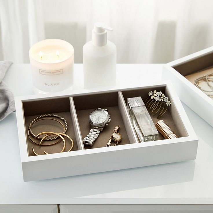 Beautifully simple and wonderfully practical, this sleek, white lacquer jewellery tray is designed to perfectly hold a collection of necklaces, rings, earrings or bracelets within three organised sections. Lined with a lovely soft-grey felt, it looks sleek upon any side table and can even be used within your dressing-table drawers. What makes this tray so special is that it can be stacked beneath our matching White Lacquer Jewellery Box for extra storage. Finished with a slatted base, this…