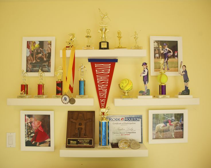 Trophy display, Hayden Simply White Ledge shelves from Pottery Barn Kids, photos incorporated.