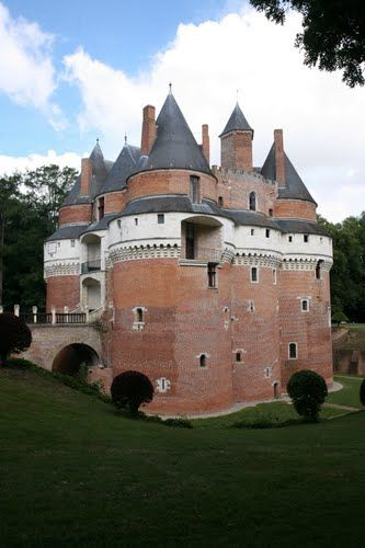 Château de Rambures, Rambures, Somme, France. The château was constructed in the Middle Ages in the style of a military fortress of the 15th century. It was one of the first castles in Europe to be constructed almost exclusively in bricks.The castle is set in a park, the Parc et Roseraie du Château de Rambures containing a rose garden and ancient trees. It has been classified as a monument historique by the French Ministry of Culture since 1927.