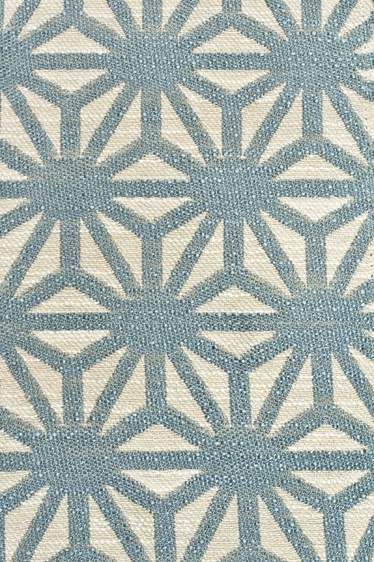 Starburst Woven Fabric A woven cloth with a geometric design in sky blue  and off