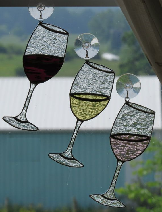 These handmade stained glass wine glass suncatchers are the perfect gift for the wine-lover in your life! (And we ALL know someone who loves wine!)  Available in three colors: ~ Merlot (burgundy) ~ Rose (pink) ~ Chardonnay (pale yellow/white). (Listing is for ONE wine glass.)  Approximately 7.25H x 2.75W  (Suction cup included with all suncatcher purchases.)  NOTE ABOUT SALES TAX: We are required by law to collect sales tax for orders being delivered to New York State.