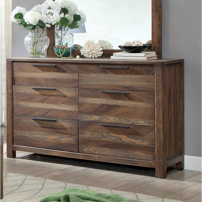 With a warm woodsy feel that'll bring the feeling of the outdoors to your bedroom, this dresser is the perfect complement to your transitional furniture. Featuring an inviting rustic natural tone finish, this piece adds warmth to your room. Each of the six drawers come with a metal bar pull along the front to work in tandem with the full-extension side metal glides for a smooth opening and closing experience. Supported atop sturdy block feet, this piece brings the attractiveness of the…