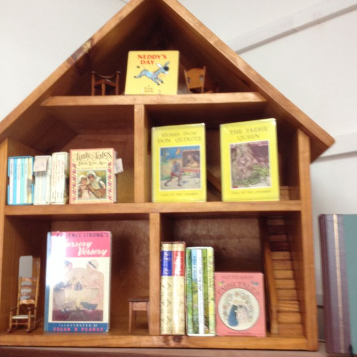 Dolls' house used for display of small vintage books full of nostalgia!