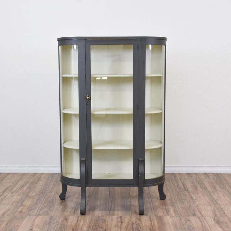 This Curved Curio Cabinet Is Featured In A Solid Wood With