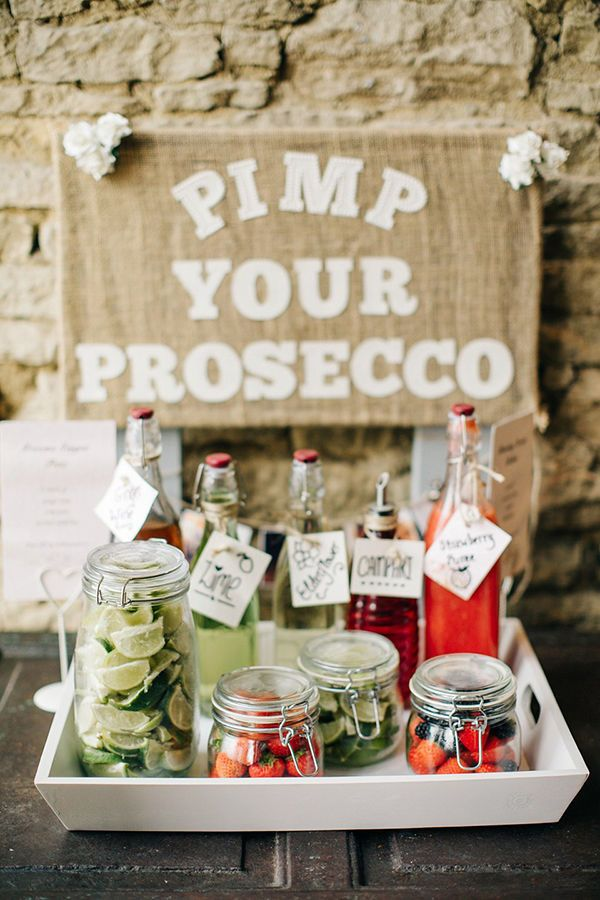 Make Your Own Bubbly: This prosecco bar isn't just delicious, it also adds pops of bright color to any engagement party or country wedding reception. This country-themed event used canning jars to hold fruit, but you can find decorations to fit any style decor. Use hobnail milk glass dishes for a vintage theme or wicker containers for a retro version.