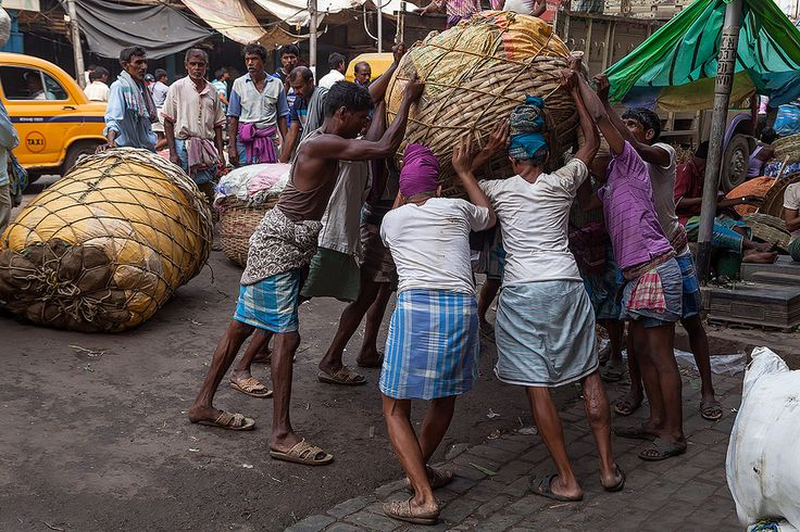 https://flic.kr/p/pnqwcq   Pure muscle at the vegetable wholesale market in Kolkata, India.   Just looking takes your breath away, imagine 35 degrees Celsius with 100% humidity...these guys have one of the toughest job anyone can imagine! Read more about the markets in Kolkata here.  Follow us on Twitter or Cookiesound