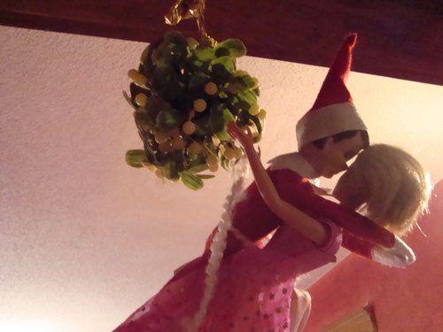 Elf on the Shelf: kissing Barbie under the mistletoe