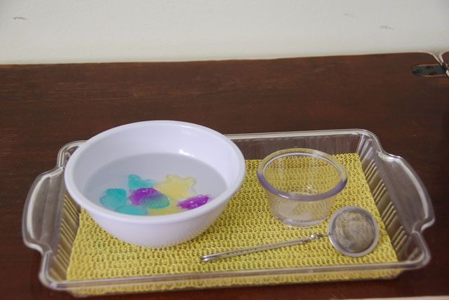 Scooping out of water. http://www.justmontessori.com/practical-life/