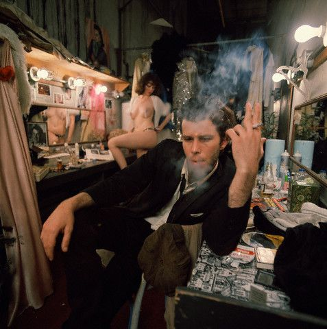 Tom Waits (Cassandra Peterson, stripper in background – aka Elvira, Mistress of the Dark), Small Change cover photo shoot. –Image by © Joel Brodsky/Corbis