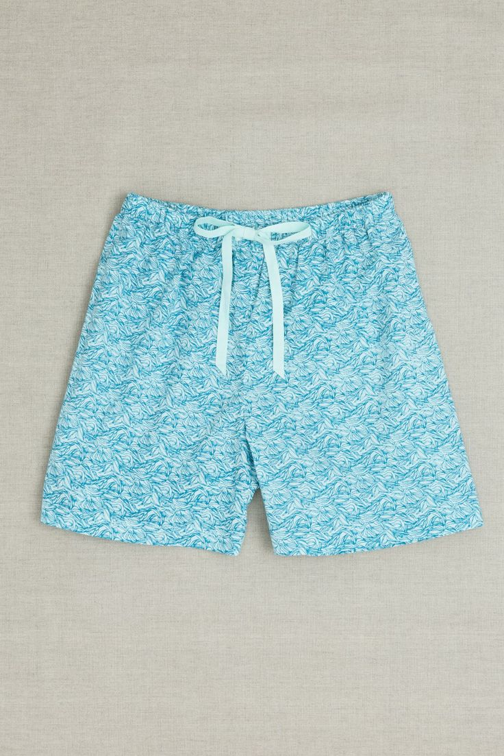 Moonbird classic shorts have an elastic waistband and cotton drawstring for an adjustable fit. Our comfortable loose shorts are made from beautifully soft 100% GOTS certified woven organic cotton and are hand screen printed with Sea Leaf print. Shorts have french seams and cotton care labels for extra comfort. Cotton brand label can also be used as a hanging loop. Printed and made in Jaipur, India in a Fair Trade accredited facility. $50 AUD