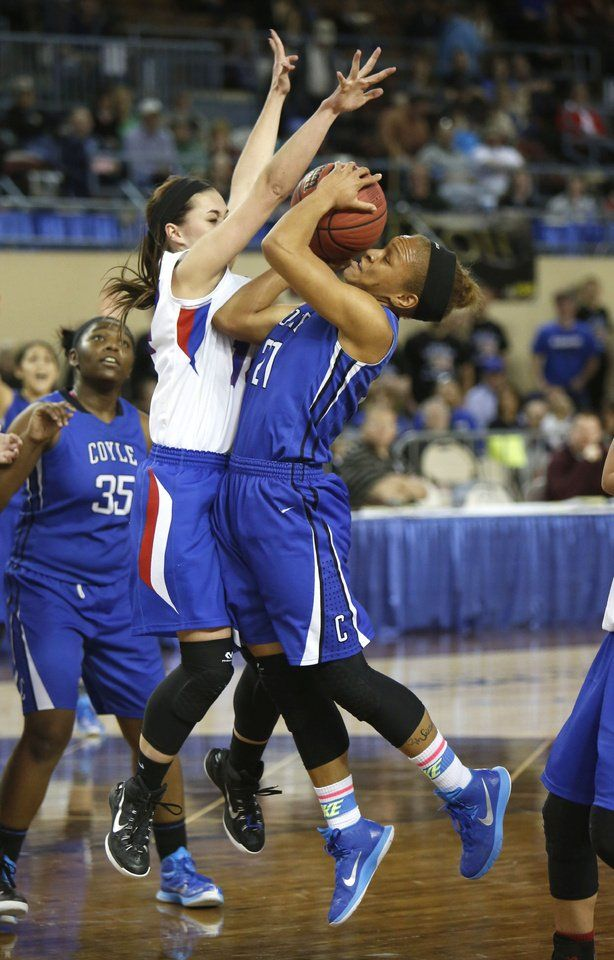 Coyle's Tyra Aska tries to get a shot past Ft. Cobb-Broxton's Mikayla Sebastian during the Class B girls semifinals basketball game between Coyle High School and Ft. Cobb-Broxton High School at the State Fair Arena in Oklahoma City, OK, Friday, March 6, 2015,  Photo by Paul Hellstern, The Oklahoman