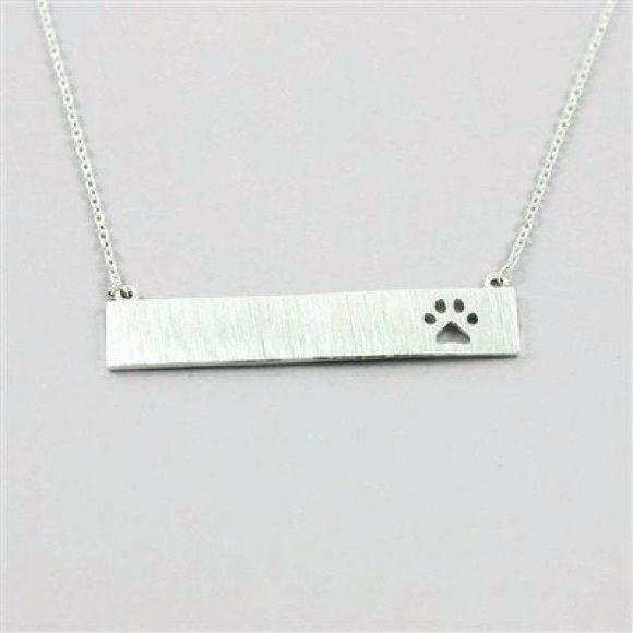 "Silver Bar Elegant Necklace With Dog Paw Cutout Keep Memories of Your Widdle Monster Close To Your Heart At All Times With THis Silver Bar Necklace With Dog Paw Cutout!  Approx. Bar size: 1- 3/8"" x 1/4""  Approx. Chain length: 16"" with 2"" extension  Material: Silver plated brass IBestest.com Jewelry Necklaces"