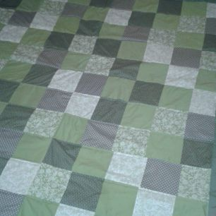 Green patchwork quilt for king size bed
