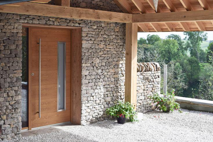 Bespoke JeTrae Alpha entrance door with integrated sidelight, vision panel and slam shut mechanism.
