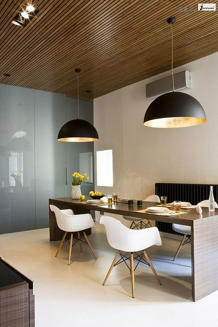 Interesting idea... They put the wood on the ceiling rather than the floor. Mixed with neutral colors and a combination of curved and straight lines, it all comes together to form an ultra-sleek modern look.
