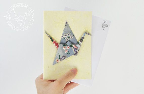 Introducing new origami greeting cards at the Teeny Folds shop on Etsy. These handmade cards are blank on the inside, making it perfect for any greeting, any occasion. This beautiful card is a grey floral peace crane on pale yellow card. #etsy #origami #crane #stationery #handmade #cards