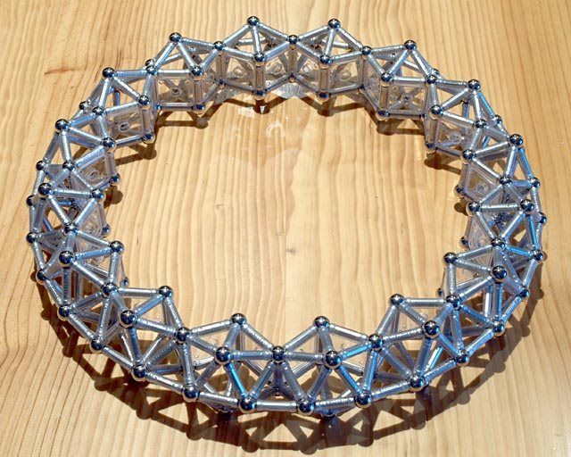 GEOMAG constructions: Ring of 16 sphenocoronae