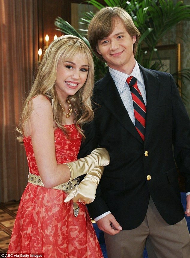 Close co-stars: Miley began her heartfelt post on Thursday by giving a shout-out to her former onscreen brother Jason Earles (pictured on Hannah Montana in 2006)