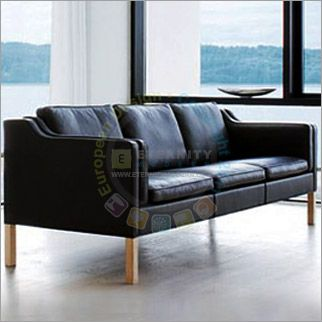 This sofa was designed in 1962 by Borge Mogensen for use in his home in Gentofte. The Borge Mogensen Sofa is very minimal, and the simplicity and classic style have made this line one of Mogensen's most popular designs. It is upholstered in premium leather and includes down and foam filled seat and back cushions, providing comfortable and spacious seating. It's also commonly referred to as the Borge Mogensen 2212 Sofa.