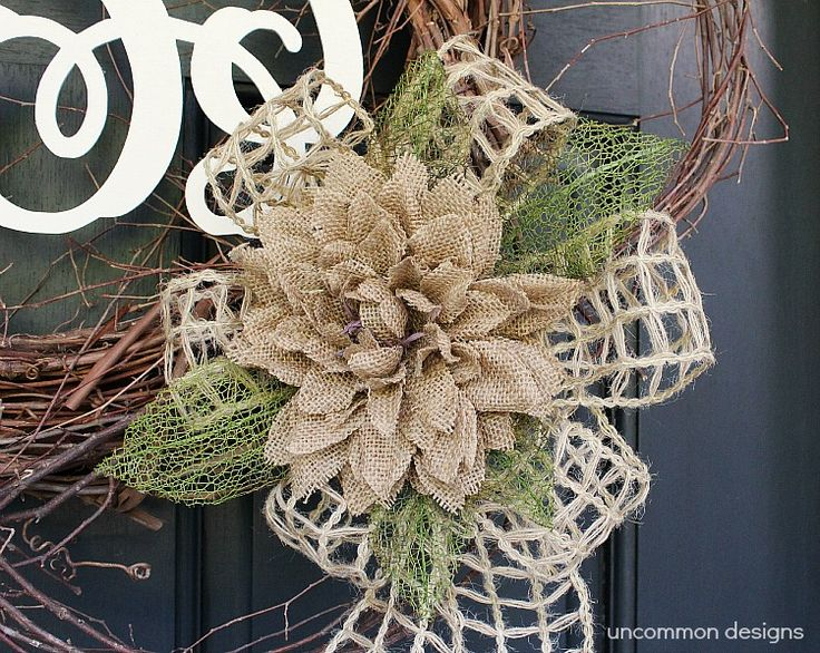 Monogram-wreath-burlap-flower.  Uncommon Design says:  When I found this adorable Burlap Dahlia Flower at Hobby Lobby ready made, I was thrilled! Perfect! It even had these amazing wired green leaves to give a little pop of color.  Next I needed ribbon, and I found this open weave, jute twine wired ribbon…See Tutorial.