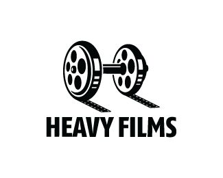 Heavy Films Logo design - Logo design of a dumbbell made from movie reels.<br /> Price $340.00