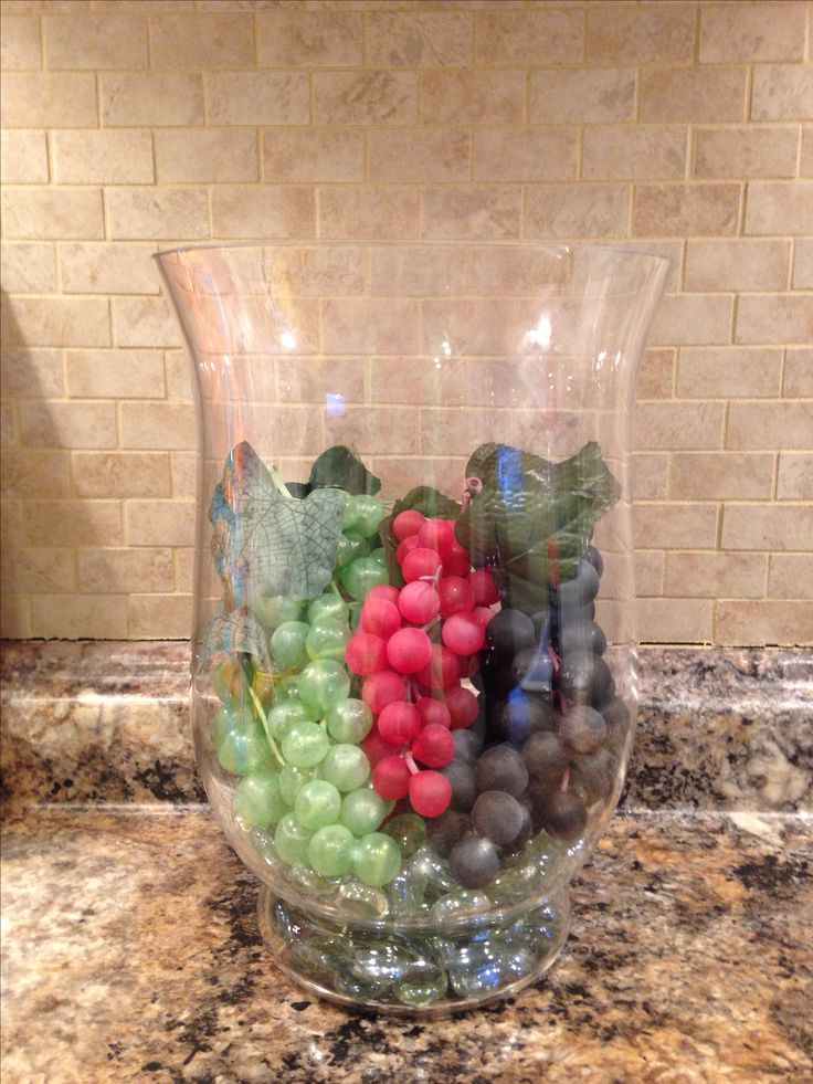 Cheap dollar store grapes and a hurricane! Great for kitchen wine decor! It's what my kitchen is all about!