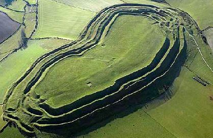 Maiden Castle- The hillfort was first occupied in about 3,000 BC,built over an earlier neolithic settlement, it consists of a complex series of multiple ramparts and ditches. The name 'Maiden' derives from the ancient Celtic words 'Mai Dun' meaning great hill. Flint tools and other objects dating from Neolithic times have been found on the site.