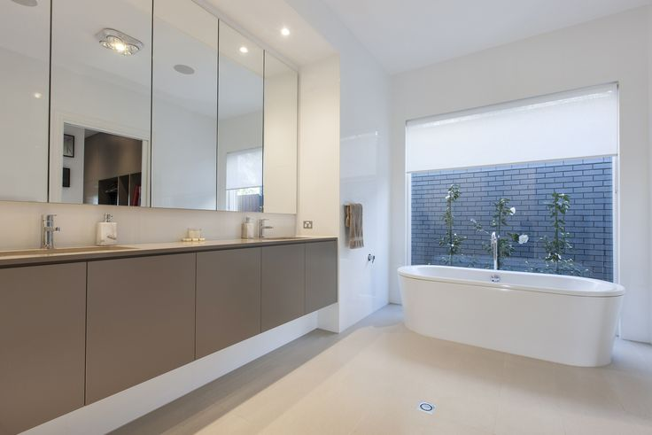 The full height window behind the free standing bath ensures a tranquil outlook