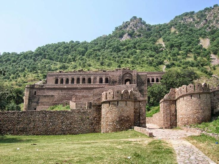 The Most Haunted Places in India Bhangarh is a deserted town with some 10000 dwellings built in 1613 by a son of great Mughal general, Man Singh of Akbar, his name was Adho Singh, This town was abandoned soon after being built and supposedly after it was cursed by a witch. Bhangarh fort brings the traveler to medieval India. The Bhangarh town had been desolated by an old mughal invasion, and is just reverting back to being habited again.