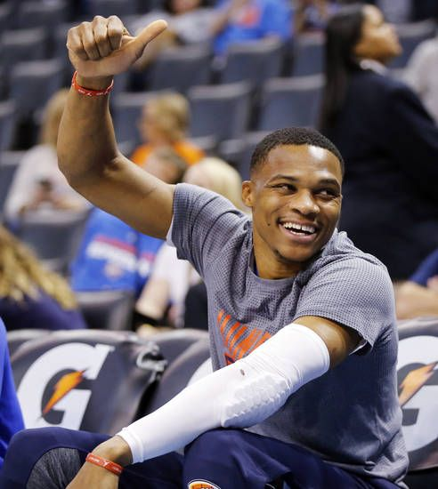 Oklahoma City's Russell Westbrook (0) gives a fan a thumbs up after seeing a sign supporting him before an NBA basketball game between the Oklahoma City Thunder and Los Angeles Clippers at Chesapeake Energy Arena in Oklahoma City, Friday, Nov. 11, 2016. Photo by Nate Billings, The Oklahoman