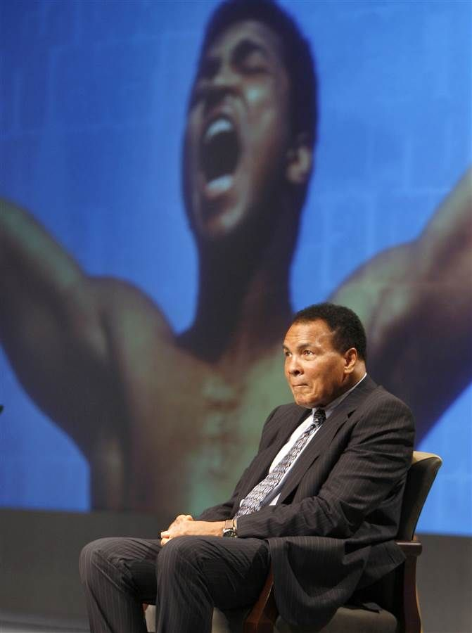 Muhammad Ali sits on the stage during an announcement marking a new philanthropic initiative in the Lexington Convention Center in Lexington, Ky., May 19, 2009. Ali, his wife Lonnie Ali, and Alltech founder and president Pearse Lyons made the announcement of the Alltech-Muhammad Ali Center Global Education and Charitable Fund. Charles Bertram / The Herald-Leader via AP file