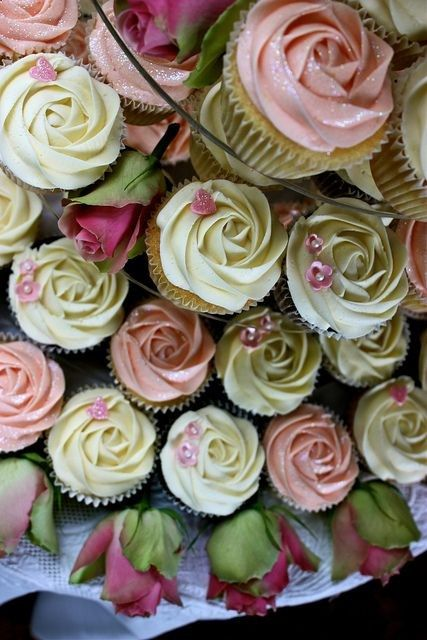 Pink  Ivory Rose Wedding Cupcakes by ConsumedbyCake- I love the idea of having a small wedding cake for the wedding party and family members, and having large, beautifully decorated cupcakes in two or three flavors for the guests to enjoy. Would make serving faster, and everyone could pick their own cake experience. :)