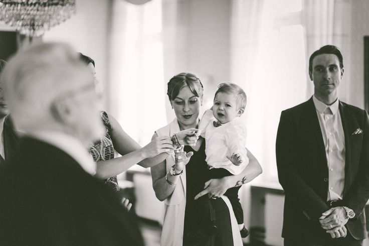 That moment when the couple's toddler son doesn't want to be in anyones arms but his parents. Little man got to spend the rest of the ceremony in his dads arms.   Gold and Grit Photography