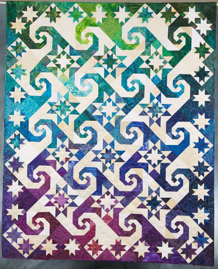 Awesome blog: Quilt Inspiration: Straight piecing patterns that appear curved: Snail's Trail and Kaleidoscope