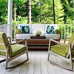 porches - green mid-century modern rocking chairs white outdoor sofa turquoise blue green pillows wraparound porch  Fantastic porch design with