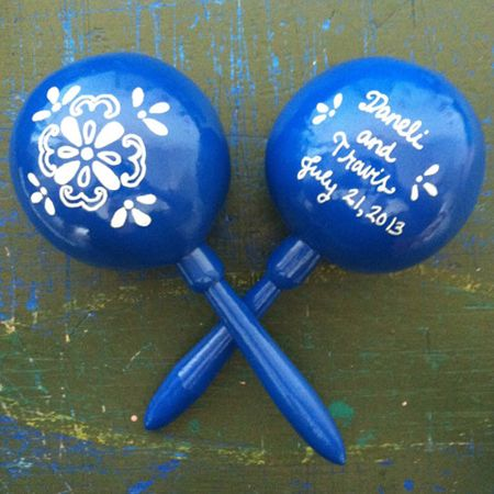 For a Mexican, Tex-Mex, or fiesta inspired wedding, personalized maracas are a festive decoration that double as favors.