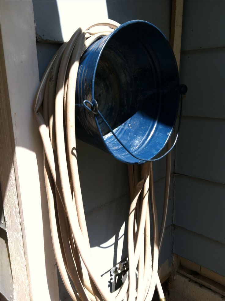 repurpose Bucket to a Water Hose Holder...not sure where/if I can do this, for a good support at house......Old bucket, screw to outside wall. Water hose holder! [frugal, reuse, repurpose]