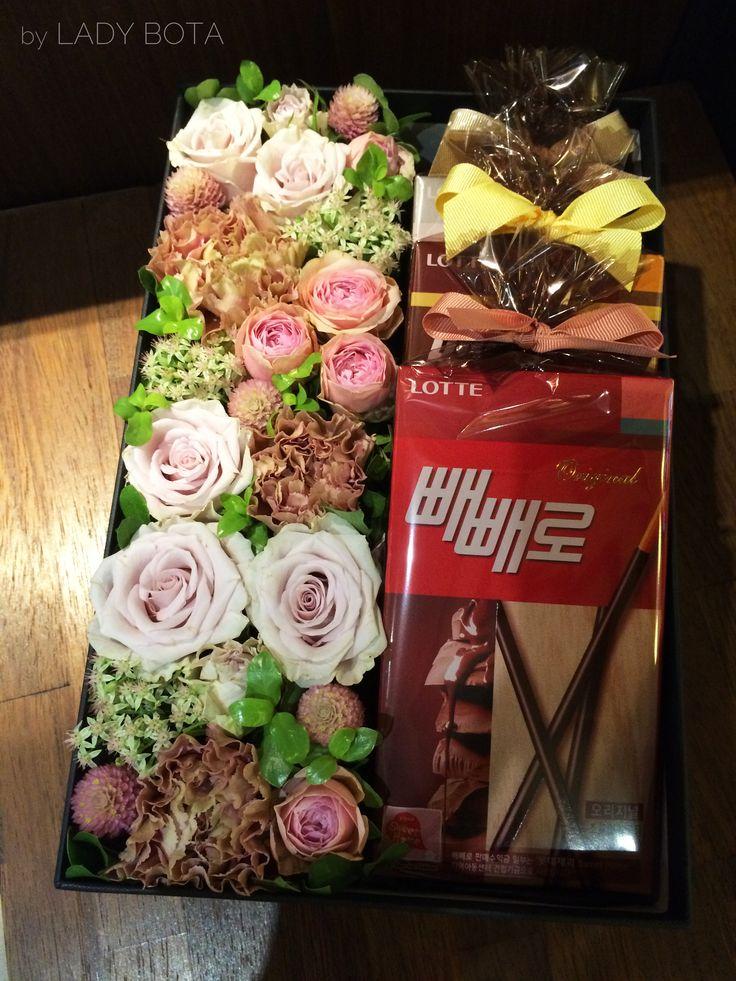 a flower box with 'Pepero'(Korean chocolate biscuit) www.ladybota.com