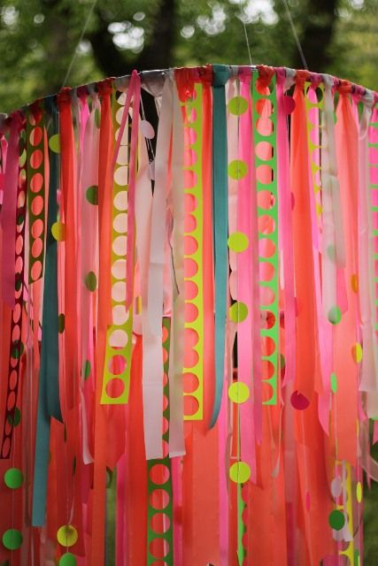 ribbon chandelier- hula hoops aren't just for shakin your hips anymore.  This festive party decor could be hung anywhere.   I think they would be especially cool hanging from an arbor at an outdoor event.
