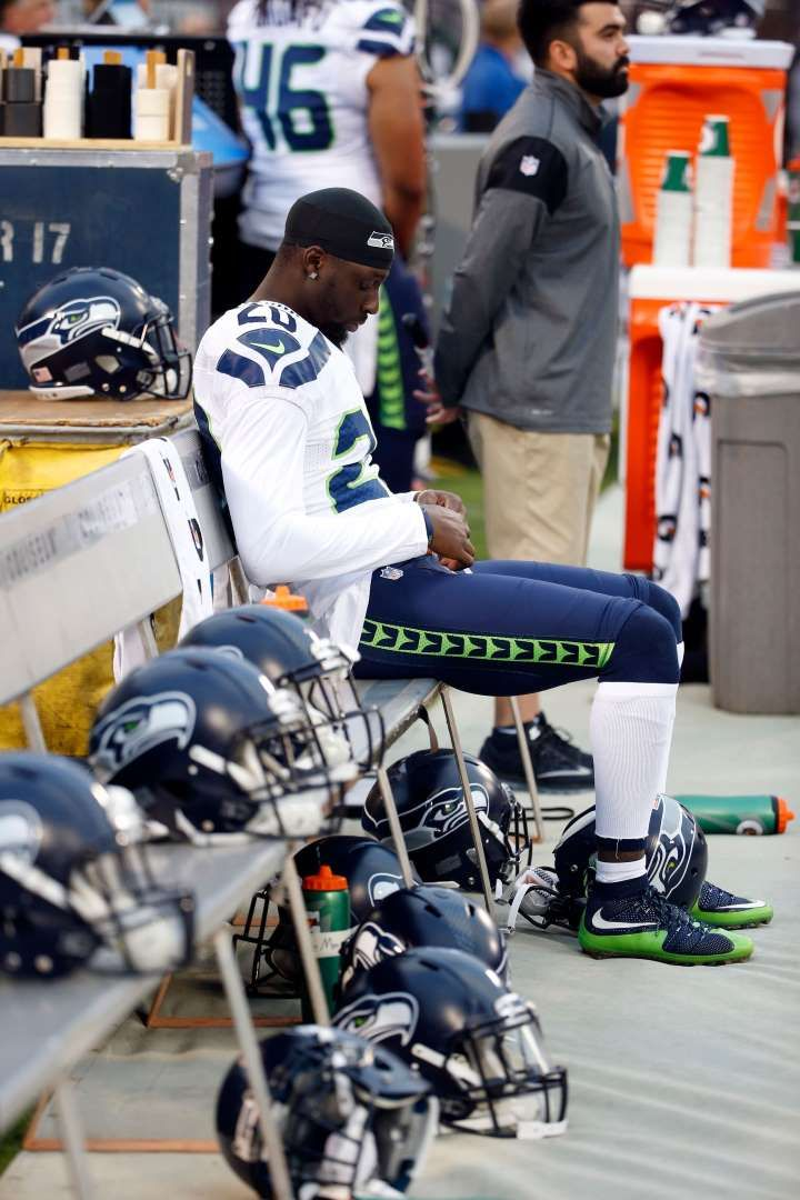NFL players' national anthem protests   -  Seattle Seahawks cornerback Jeremy Lane sits as the national anthem plays before a preseason game against the Oakland Raiders Thursday, Sept. 1, 2016, in Oakland, Calif.