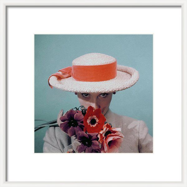 Fashion Framed Print featuring the photograph A Model Wearing A Straw Hat by Clifford Coffin