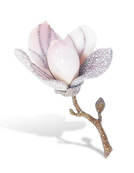 A RARE CONCH PEARL, COLOURED DIAMOND AND DIAMOND BROOCH, BY ETCETERA  Designed as a blossoming flower centering upon a conch pearl pistil, within a conch pearl shell surround accented by vari-cut pink and colourless diamonds and a petal pavé-set with similarly-cut and coloured diamonds, joined to the brilliant-cut colourless, yellow and brown diamond sepal extending to the stem, mounted in 18k white gold