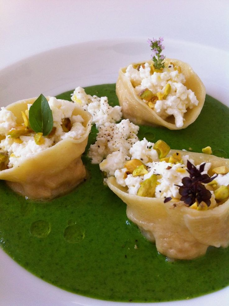 smoked chicken ravioli with cottage cheese, spinach and pistachos