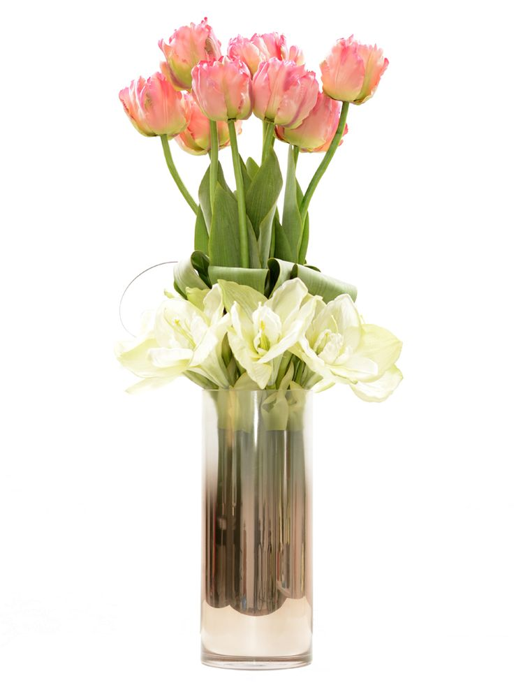 Tall arrangement with pink tulips and white amaryllis.