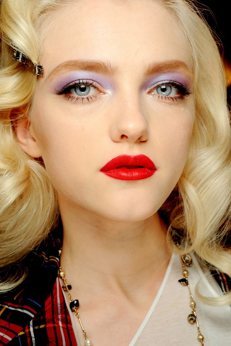 Pretty holiday makeup with light purpley fuschia eye.  Fresh take on a bright red lip.