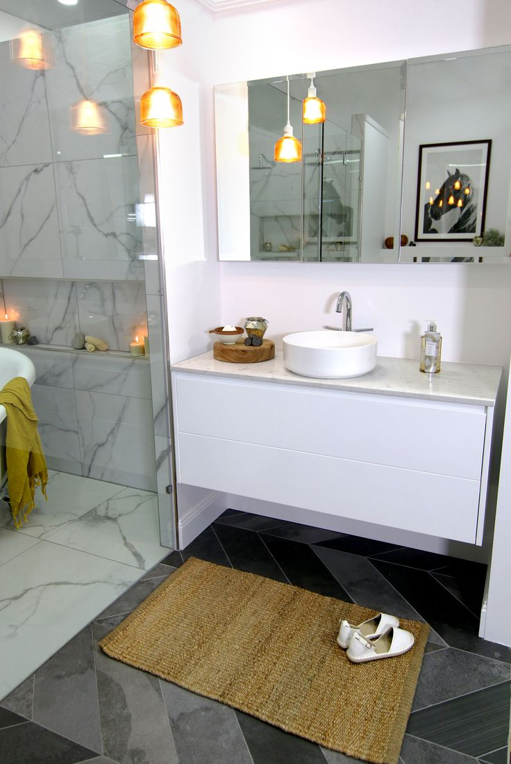 Jess' wall hung vanity unit with stone top and round Eden fine lines basin