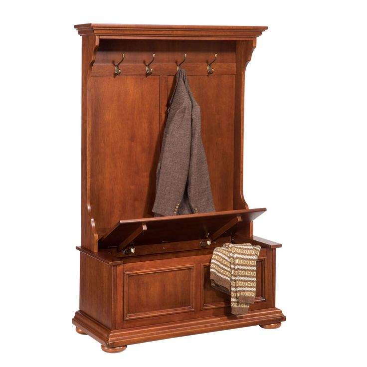 Home Styles Homestead Hall Tree is constructed of hardwood solids and veneers in a rich distressed nutmeg finish. Design includes crown molding top with contoured sides, four antique brass finished ho